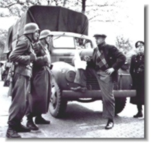 Dutch driver talking to German guards